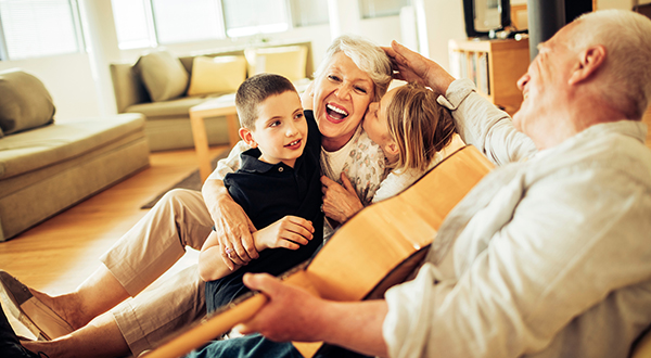 Grandparents sitting with their grandchildren stock photo